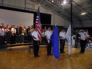 Tony Hardway leads the Color Guard and VVHS choir in singing the National Anthem to kick off the special tribute to veterans of all wars during the Festival of Trees which was held at the Casablanca Event Tent Nov. 18-21. Photo by Teri Nehrenz.