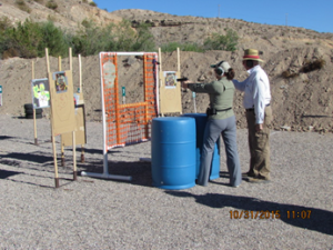 Pam Pitcher defending the Mesquite Shooters Pistol Range from the marauding Zombies as Chief Range Safety Officer Ken Ness times and controls the shoot. Submitted photo.