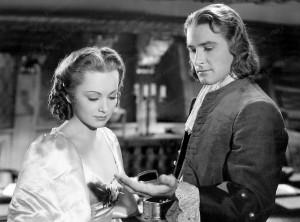 Olivia de Havilland and Errol Flynn in a still from Captain Blood - Warner Bros