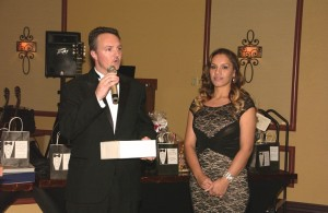 Ryan Yost, left and Janet Perez accept the Business of the Year award on behalf of their employer Eureka Casino Resort at the Mesquite Chamber of Commerce Black and White Holiday Gala, Dec. 5. Photo by Burton Weast.