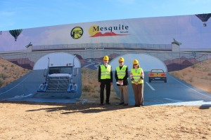 George Gault, MRBI President, left, Mesquite Mayor Al Litman and RSC General Manager for Do It Best Corporation Wendy Kenny, stand in front of a depiction of the new I-15 Exit 118 interchange on Wednesday, Dec. 2. at the groundbreaking ceremony. Photo by Barbara Ellestad.
