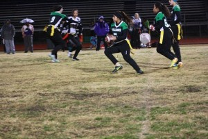 Bulldog Katie Zuniga races around left end for a long gainer during the Lady Dawgs win over Sunrise Mountain Friday night, Dec. 11. The Dawgs prevailed 32-6 on a cold wet night behind two T.D.'s from Zuniga. Photo by Lou Martin.