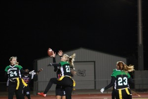 Lady Dawg Falen Hafen #21 goes high to break up a Warrior pass. Hafen had an interception to set up the Bulldogs second T.D. of Tuesday night's win over Western High School. Photo b Lou Martin.