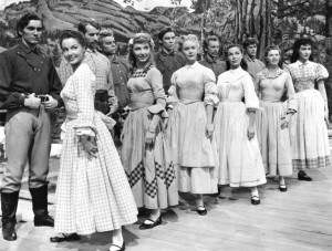 Cast of Seven Brides for Seven Brothers. Ruta Lee, second from left opposite Matt Mattox - MGM
