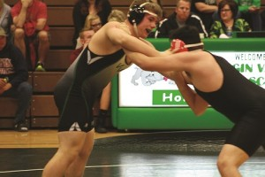 Bulldog wrestler Dayden Payne sets up his Cowboy opponent for a pin Tuesday night, Jan. 26 in the Dawgs House. Payne won in .52 seconds at 195 lbs. Photo by Lou Martin.