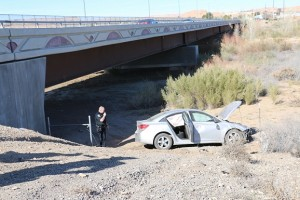 A car traveling north on SR 170 missed the curve outside of Bunkerville and traveled down the river embankment stopping near the Riverside Bridge. The sole occupant of the vehicle was transported to Mesa View Regional Hospital. Photo by Barbara Ellestad.