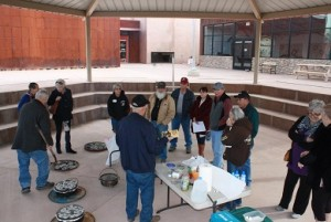 Long-time Mesquite resident Sam Reber demonstrates his passion for Dutch oven cooking to an energetic group at the Virgin Valley Heritage Museum on Saturday afternoon, Jan. 16. Photo by Lou Martin.
