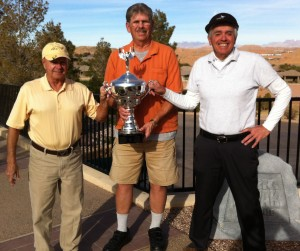 From left to right, Low Gross winner, Tim Miller is presented the Cup by MMGA President Bubba Petrick with Low Net winner Bill Irace on the right. Submitted photo.