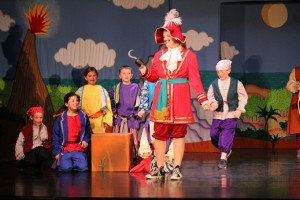 Captain Hook (Jessica Janneck) spills his evil plans to capture Peter to the Neverland pirates in the Mesquite Arts Council and Missoula Children's Theatre's version of Peter and Wendy which was performed on Feb. 6 at the Mesquite Community Theatre. Photo by Teri Nerhenz.