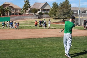 VVLLTryouts-02-27-16-02: VVHS baseball player Cade Anderson hits grounders to aspiring little leaguers Saturday morning on the VVHS ball field. Photo by Lou Martin.
