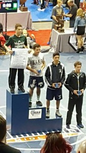 Jacob Baird stands at the top of the podium with his second State Championship Title. Baird won two of his matches by fall and the championship match 10-4. Baird finished the season 49-5. Photo courtesy of VVHSDawgs Facebook Page.