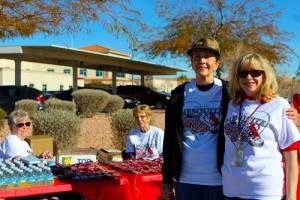 After completing the 12 Annual Heart Walk, Suzanne Saltzman coming in fourth, Maureen Wilbur, Marketing Assistant for Mesa View Hospital, greets and congratulates her friend for completing the 3.2 mile walk on Friday Feb. 12. Carol Griess and Joan Clawson (back) hand out water, apples and trail mix to the residents completing the walk. Photo by Teri Nehrenz.