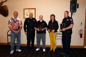 Police Chief Troy Tanner presents the Police Department honorees Mike Bennett, Kristine Fowles and Police officer of the Year Brad Tobler plaques for their outstanding work with the Mesquite Police Department. Photo by Teri Nehrenz.