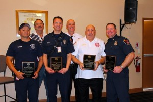 Fire Chief Kash Christopher presents plaques to the Fire fighters honored for their outstanding service to the community.  Front row:  William Martinez, Fire Fighter of the Year Spencer Lewis, Mike Benham and Ryan Thornton.  Back Row:  Elk's Exalted Ruler, Rick McDonald and Fire Chief, Kash Christopher. Photo by Teri Nehrenz.