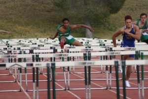 BulldogEarlyBirdTrackMeet-03-11-16.jpeg: Bulldog Darnell Wilkins completes a hurdle during the Early Bird Invitational Friday March 11. Wilkins came in third behind teammate Dallen Wolfe, far right and winner R.J. Huburt. Photo by Lou Martin.
