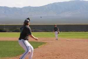 Bulldog first baseman Dallen Tanner awaits a throw from shortstop Cade Anderson during the Bulldogs 8-1 loss to Pahrump on Monday, March 14. Photo by Lou Martin.