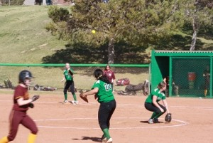 Lady Bulldog third baseman Janella Fiso #22 throws out a Trojan runner Monday afternoon, March 14 during the Bulldogs 10-1 loss to the Trojans. Photo by Lou Martin.