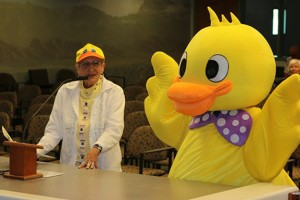 Merri Erickson, left, and the Mesquite Chamber of Commerce Derby Duck reminded the City Council and public of the annual Ducky Derby fundraiser coming up on Saturday, March 26. Photo by Barbara Ellestad.