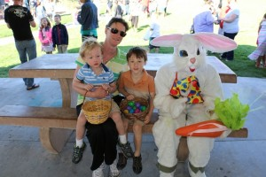 The Easter Bunny shared in the fun at the annual Easter egg hunt sponsored by the Las Vegas Summerlin Lions Club Saturday morning, March 26 as he posed for pictures with Alisha Rossell, left and her two sons, Casey and Lucas. Photo by Barbara Ellestad.