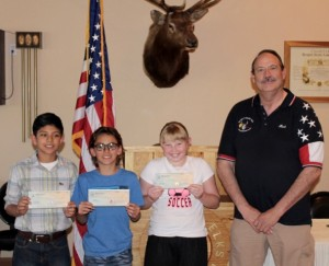 From left, 2015-16 Elks Lodge Americanism Essay Contest winners Favian Valle, Wyatt Leavitt, and Nevaen Musser and Elks Exalted Ruler Rick McDonald. Photo submitted.