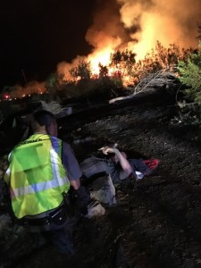 There was only one injury reported during the fire on the Arizona Strip Monday night. Mohave County Sheriff's Deputy Christofer Young lost his footing on a ladder while assisting a home owner during evacuation notices and broke his leg. Submitted photo.