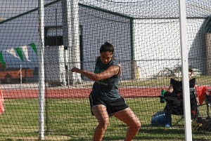Bernice Fiso winds up for her winning throw in the discus. Fiso also won the shot in her first outing of the year. Photo by Lou Martin