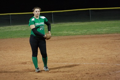 Bulldog pitcher Savannah Price stares down an Indian batter during the Dawgs 7-6 win Friday night, March 11 in the Dawg Pound. Price also had two hits for the Bulldogs. Photo by Lou Martin.