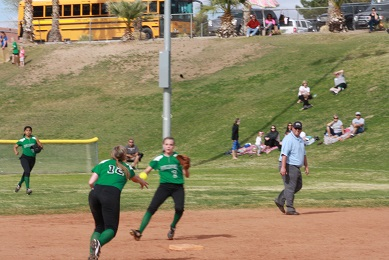 Bulldog shortstop Taylor Barnum and second baseman Kari Wakefield attempt to start a double play during the Dawgs 4-3 loss in the championship game to Aquinas High School. Photo by Lou Martin.