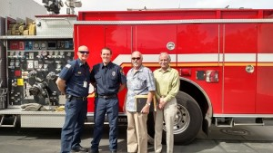 From left to right are Mesquite Fire Chief Kash Christopher, Travis Leavitt, Mayor Al Litman and City Manager Andy Barton shortly after Leavitt was sworn in as Mesquite's newest Firefighter EMT. Photo by Stephanie Frehner.