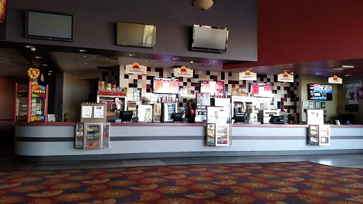It was a quiet morning for Redd Hills Cinema before they opened for the final time on March 15. Theater manager Ernest Hoffman claims that the lack of support from locals and the high fees for HOAs and state taxes played a huge roll in the demise of the business. Photo by Stephanie Frehner.