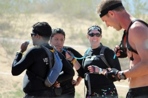 Athletes take their time to rehydrate during the eight mile Spartan Race course, some even sharing their own supply with friends and fellow competitors during the 2016 Reebok Spartan Super Race held on March 19 at the Mesquite MX Park and Hafen Ranch. Mesquite temperatures on race day climbed well into the 80's. Photo by Teri Nehrenz.