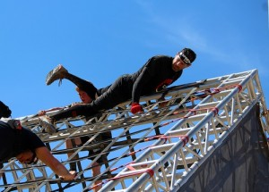 Robert Geller is a serious Spartan Racer who has been racing for three years. Geller completed the 'Super Race' course in just over two hours. Here Geller is making it over the top of a 20 ft. structure at about six miles into the eight-mile race held at the Mesquite MX Park and Hafen Ranch on March 19. Photo by Teri Nehrenz.