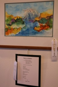 "Artist Barb Halicki and poet Karen L. Grohs took third place for their team effort titled ""Poem in a Paint Box"" at the Mesquite Fine Arts Gallery April exhibit for Artists and Poets. Photo by Barbara Ellestad."