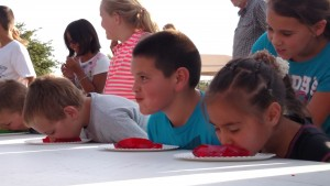 Kids and adults enjoyed their fair share of eating contests for free at the first annual Family Fun Night in 2015. This year looks to promise that and possibly more due to the outpouring support from the community and the success of the event last year. Photo by Stephanie Frehner.