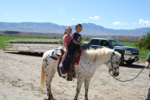Chloe Johnson, left, and Charlie Davis got to ride horses when they made a field trip to the Hafen Ranch with their fellow kindergarteners. Photo submitted.