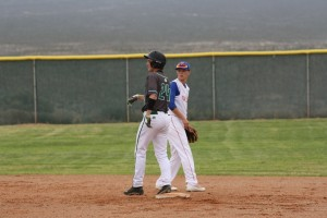 Bulldog Dillon Fuqua #24 pitched and batted his way to a 9-1 victory over Sunrise Mountain Friday April 8. Fuqua threw a four hitter and struck out 11 for a complete game. Photo by Lou Martin (recent game)