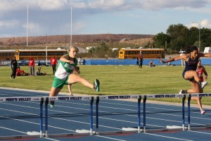 RichardLewisInvitationalTrackMeet-04-15-16-01: Bulldog Abi Barnum shows perfect form as she clears the last hurdle to take first place in the 300 meter hurdles at Moapa Valley High School Friday, April 15. Photo by Lou Martin.