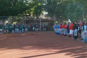 VVLL President Dan Wright, surrounded by players, introduced the program for the league's season opener Monday night at the Old Mill ball fields. Photo by Lou Martin.
