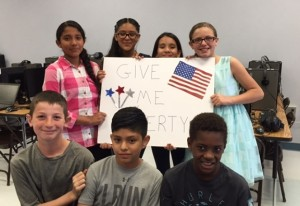Bowler Elementary School fifth grade students are proud to hold the sign of the program that teaches them the principals of Americanism.  Photo submitted.