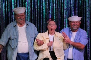 Claudette Rellas plays 'Bloody Mary' while her South Pacific naval escorts, Phil Brittain and Mike Schultz, fawn all over 'The Girl they Love.'  Photo by Teri Nehrenz.