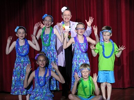 Claudette Rellas and the Mesquite Toes Kids share some 'Happy Talk' with the audience during the Mesquite Toes Spring Dance Spectacular held at the Mesquite Community Theatre on April 14, 15 and 16.  Kids (not in order):  Brooke Helsten, Connor Helsten, Samantha Davis, Sarah Davis, Aiden Steyee and Maddy Steyee.    Photo by Teri Nehrenz