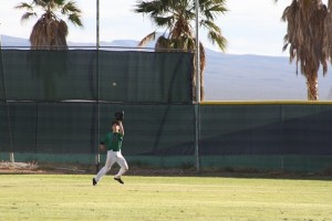 Bulldog centerfielder Jayden Perkins settles under a fly ball during a recent Bulldog game. Perkins had two hits and scored two runs during the Dawgs loss to Desert Pines Wednesday in the Dawg Pound. Photo by Lou Martin
