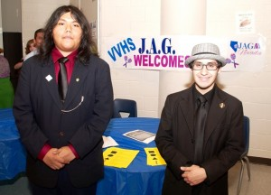 Samuel Meiendrez and Omar Flores of the JAG program greeting visitors at Virgin Valley High School's first Career and Technical Education and Arts Night on April 28. Photo by Burton Weast.
