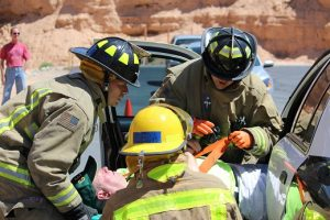 Fire Cadet final training before graduating the academy was held Saturday, May 21 at the training facility located behind fire station #3.  Here cadets are trained on a simulated multiple vehicle accident and rollover.  Photo by Teri Nehrenz