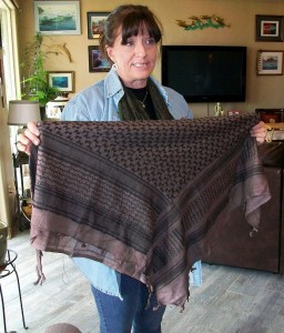 Tina Brayford, a survival specialist, shows a group of women how much of a difference a piece of material or a shawl such as this one can make when in an emergency situation. Photo by Becky Hoff.