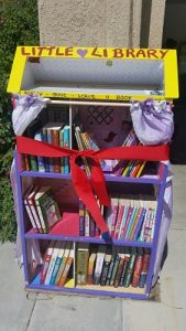 The Little Library shelves with the ribbon ready for cutting. Photo courtesy of Kathy Morris