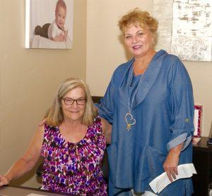 Mary Hanlon, birth parent support services and standing, Ellen Sorensen outreach coordinator for Premier Adoption Agency. Photo by Burton Weast.