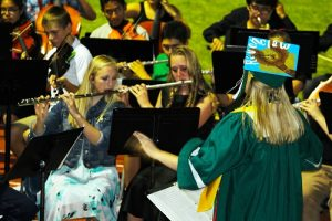 Virgin Valley High School Class of 2016 Valedictorian Savannah Browning admittedly did not write a speech but instead chose to lead the band in a song dedicated to her class.  Photo by Teri Nehrenz