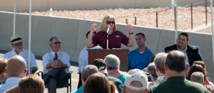 "Among other dignitaries offering comments at the new I-15 Exit 118 interchange grand opening is Wendy Kinney, RSC General Manager for Do It Best Corporation, who said ""We've been waiting 10 years for this day."" Photo by Kris Zurbus."
