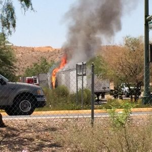 This semi-truck hauling a load of empty plastic pallets Wednesday ignited in flames after a piece of shredded tire became stuck in the trailer's axle. Photo by Grace Russell.